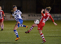 20140221 - OOSTAKKER , BELGIUM : duel pictured between Gent Jassina Blom (l) and Antwerp Marlies Verbruggen (r) during the soccer match between the women teams of AA Gent Ladies  and RAFC Antwerp Ladies , on the 19th matchday of the BeNeleague competition Friday 21 February 2014 in Oostakker. PHOTO DAVID CATRY