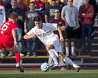 Boston College midfielder/defender Colin Murphy (21) brings the ball forward.  Rutgers University defeated Boston College in penalty kicks after two overtime periods in NCAA Division I tournament action, at Newton Campus Field, November 20, 2011.