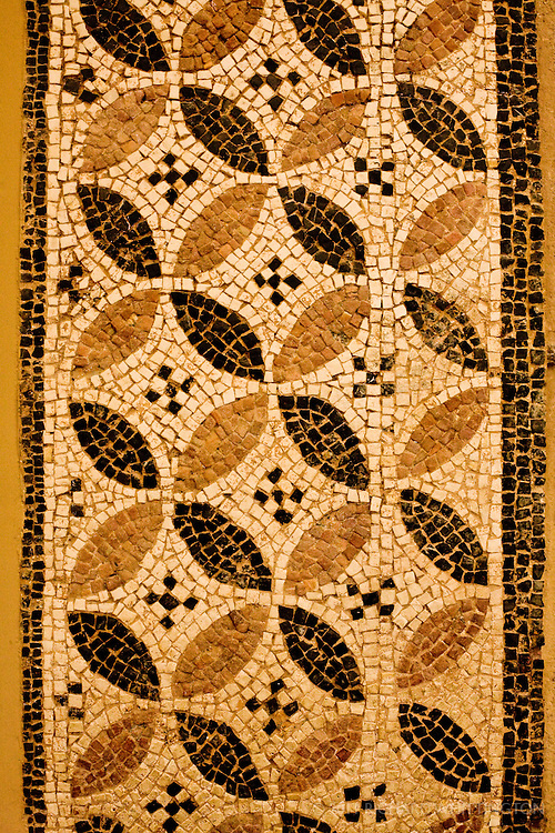 This intricate Greek mosaic can be found at the Acrocorinth Museum in Greece.