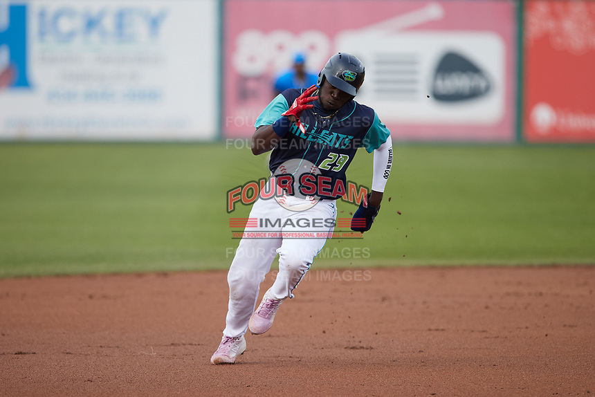 Jhonkensy Noel (29) of the Lynchburg Hillcats hustles towards third base against the Myrtle Beach Pelicans at Bank of the James Stadium on May 22, 2021 in Lynchburg, Virginia. (Brian Westerholt/Four Seam Images)