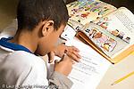 Education Elementary school Grade 2 English language arts test male student at work at desk horizontal