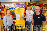 Kevin Barry (front right) with his son Kevin and Maeve McElligott in his shop Kevin Barry's and  are promoting the Austin Stacks GAA Club lotto.