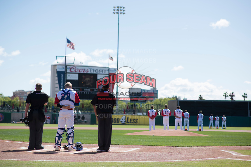 The Stockton Ports and umpires during the playing of the National Anthem during a California League game against the San Jose Giants on April 9, 2019 in Stockton, California. San Jose defeated Stockton 4-3. (Zachary Lucy/Four Seam Images)