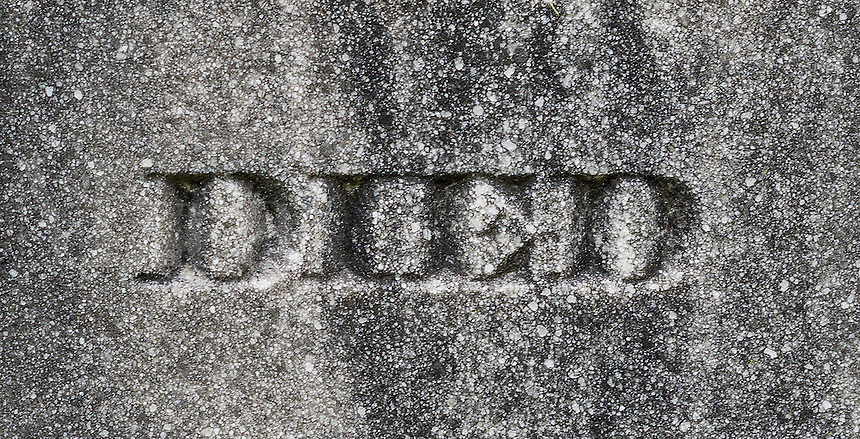 """The word """"Died"""" etched on a grave stone."""