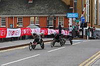 3rd October 2021; London, England: The Virgin Money 2021 London Marathon: Aaron Pike of USA leading a group across Narrow Street Swing Bridge, Limehouse Basin between mile 14 and 15.