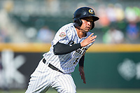 Ronald Bueno (16) of the Charlotte Knights hustles towards home plate against the Gwinnett Braves at BB&T BallPark on July 16, 2017 in Charlotte, North Carolina.  The Knights defeated the Braves 5-4.  (Brian Westerholt/Four Seam Images)