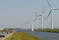 Holland Vestas Windmill at canal with sailing boat / Holland Vestas Windkraftanlagen an einem Kanal mit Segelboot