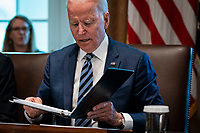 United States President Joe Biden looks over his notes during a cabinet meeting at the White House in Washington, D.C., U.S., on Tuesday, July 20, 2021. Biden administration officials say they're starting to see signs of relief for the global semiconductor supply shortage, including commitments from manufacturers to make more automotive-grade chips for car companies. <br /> Credit: Al Drago / Pool via CNP /MediaPunch