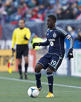 Sporting Kansas City substitute midfielder Peterson Joseph (19) looks to pass.  In a Major League Soccer (MLS) match, Sporting Kansas City (blue) tied the New England Revolution (white), 0-0, at Gillette Stadium on March 23, 2013.