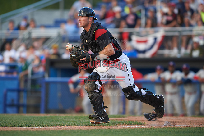 Batavia Muckdogs catcher David Gauntt (7) chases a runner back to third in a rundown as pitcher Alex Mateo (37) backs up the play during a game against the Auburn Doubledays on June 19, 2017 at Dwyer Stadium in Batavia, New York.  Batavia defeated Auburn 8-2 in both teams opening game of the season.  (Mike Janes/Four Seam Images)