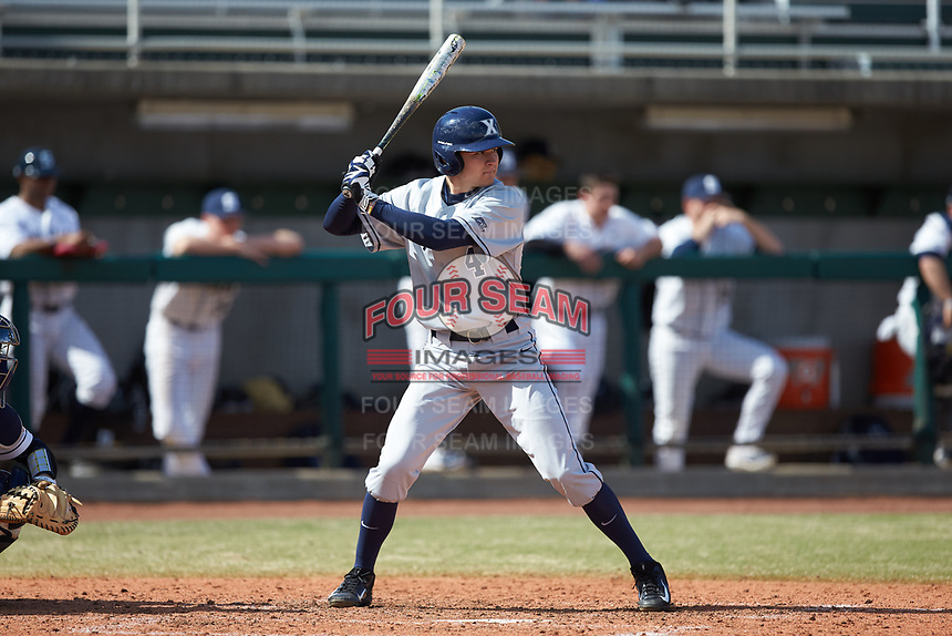 Conor Grammes (4) of the Xavier Musketeers at bat against the Penn State Nittany Lions at Coleman Field at the USA Baseball National Training Center on February 25, 2017 in Cary, North Carolina. The Musketeers defeated the Nittany Lions 10-4 in game one of a double header. (Brian Westerholt/Four Seam Images)