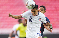 ZAPOPAN, MEXICO - MARCH 21: Sebastian Saucedo #10 of the United States heads a ball during a game between Dominican Republic and USMNT U-23 at Estadio Akron on March 21, 2021 in Zapopan, Mexico.