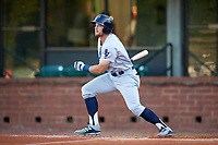 Pensacola Blue Wahoos center fielder Brian O'Grady (21) follows through on a swing during a game against the Mobile BayBears on April 25, 2017 at Hank Aaron Stadium in Mobile, Alabama.  Mobile defeated Pensacola 3-0.  (Mike Janes/Four Seam Images)