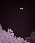 Turkey Creek Moon (Infrared).  Here's a bit of infrared minimalism – an early spring half moon above the red sandstone cliffs overlooking the Turkey Creek trail.  A blue sky can come out very dark when photographed in infrared, as exemplified in this scene in the Coconino National Forest outside of Sedona.<br /> <br /> Image ©2020 James D. Peterson