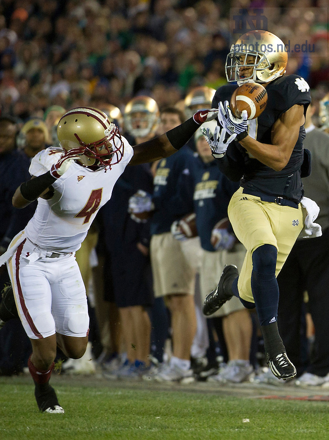 November 19, 2011; Boston College Eagles cornerback Donnie Fletcher (4) breaks up a pass intended for Notre Dame Fighting Irish wide receiver TJ Jones (7) during the second quarter. Photo by Barbara Johnston/University of Notre Dame.