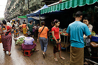Food vendors in and around the chinese market of<br /> Yangon, Myanmar, on a sunny day of July 2017