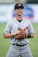 Tyler Filliben (14) of the West Virginia Power warms up in the outfield prior to the game against the Kannapolis Intimidators at Intimidators Stadium on July 3, 2015 in Kannapolis, North Carolina.  The Intimidators defeated the Power 3-0 in a game called in the bottom of the 7th inning due to rain.  (Brian Westerholt/Four Seam Images)