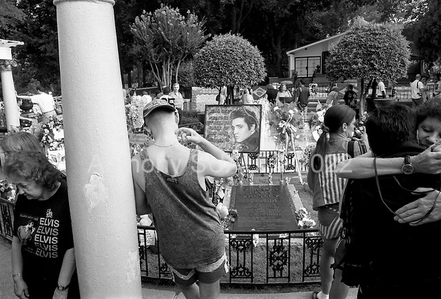 """Memphis, Tennessee<br /> USA<br /> August 11, 2002<br /> <br /> Elvis Presley fans from around the world visited his grave at Graceland during """"Elvis Week"""" to honor the 25th anniversary of his death."""