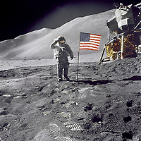 """1971-07-26, File Photo - Apollo 15 Commander Dave Scott salutes the American flag at the the Hadley-Apennine lunar landing site. The Lunar Module """"Falcon"""" is partially visible on the right.<br /> <br /> Apollo 15 was the ninth manned mission in the Apollo program and the fourth mission to land on the Moon. It was the first of what were termed """"J missions"""", long duration stays on the Moon with a greater focus on science than had been possible on previous missions. The mission began on July 26, 1971, and concluded on August 7th.<br /> <br /> Commander David Scott and Lunar Module Pilot James Irwin spent three days on the Moon and a total of 18¬Ω hours outside the spacecraft on lunar extra-vehicular activity. <br /> <br /> Image Credit: NASA"""