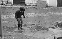 Jumping and splashing in puddles, Summerhill school, Leiston, Suffolk, UK. 1968.