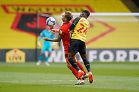 James Collins of Luton Town (19) and Tom Dele-Bashiru (24) of Watford during the Sky Bet Championship match between Watford and Luton Town at Vicarage Road, Watford, England on 26 September 2020. Photo by David Horn.