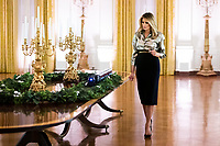2020 White House Christmas<br /> <br /> First Lady Melania Trump walks alongside the White House Express train in the East Room of the White House Sunday, Nov. 29, 2020, during her review of the Christmas decorations. (Official White House Photo by Andrea Hanks)