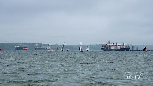 Container ships in Cork Harbour - two outbond and one inbound  with dinghy sailing on the Curlane Bank