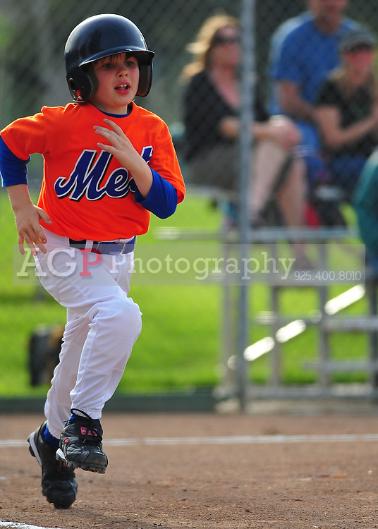 The Pleasanton National Little League A Mets play at the Pleasanton Sports Park Tuesday March 16, 2010. (Photo by Alan Greth)