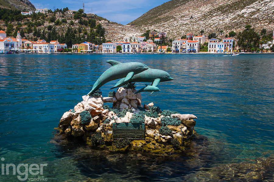 Dolphin sculpture in the harbour at Kastellorizo, Greece