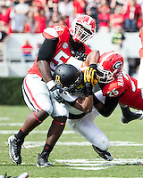 The Georgia Bulldogs beat the App State Mountaineers 45-6 in their homecoming game.  After a close first half, UGA scored 31 unanswered points in the second half.  Appalachian State Mountaineers running back Marcus Cox (14), Georgia Bulldogs safety Josh Harvey-Clemons (25), Georgia Bulldogs defensive end Sterling Bailey (58)