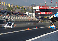 Feb 9, 2018; Pomona, CA, USA; NHRA funny car driver John Force explodes the carbon fiber body off his car alongside Jim Campbell during qualifying for the Winternationals at Auto Club Raceway at Pomona. Force would walk away from the incident. Mandatory Credit: Mark J. Rebilas-USA TODAY Sports