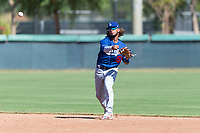 Los Angeles Dodgers shortstop Ronny Brito (58) throws to first base during an Instructional League game against the Oakland Athletics at Camelback Ranch on September 27, 2018 in Glendale, Arizona. (Zachary Lucy/Four Seam Images)