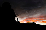 Andean Mountain Cat (Leopardus jacobita) biologist, Juan Reppucci, hiking in mountains at sunset, Abra Granada, Andes, northwestern Argentina