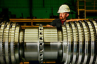An employee of Siemens Charlotte Turbine-Generator Center  Siemens state-of-the-art generator manufacturing operations include new-unit generator manufacturing as well as service repairs for steam turbines and generators. The Charlotte NC manufacturing facility was founded in 1967 by Westinghouse Electric Corporation to manufacture nuclear low pressure turbines. Siemens Charlotte plant is the primary service center for generator and steam turbine equipment in the Americas, and the lead plant for manufacturing new electrical generators. Internationally, Siemens AG is Europe's largest engineering conglomerate.