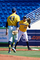 Michigan Wolverines first baseman Hector Gutierrez (24) waits for a throw from pitcher Tommy Henry (47) during a game against Army West Point on February 17, 2018 at Tradition Field in St. Lucie, Florida.  Army defeated Michigan 4-3.  (Mike Janes/Four Seam Images)