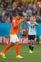 Javier Mascherano of Argentina shouting past Robin van Persie of the Netherlands