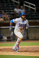 Tennessee Smokies left fielder Jeffrey Baez (33) runs to first base during a game against the Birmingham Barons on August 16, 2018 at Regions FIeld in Birmingham, Alabama.  Tennessee defeated Birmingham 11-1.  (Mike Janes/Four Seam Images)