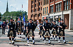 WATERBURY, CT 072421JS11  Members of the Police Pipes and Drums of Waterbury lead the parade of guests, staff, administrators and graduates from Post University to the Palace Theater for  graduation ceremonies held Saturday at the Palace Theater in Waterbury. This was a commencement for both 2020 and 2021 graduates. <br /> Jim Shannon Republican American