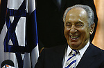 Newly elected Israeli president Shimon Peres smiles during a meeting of his Party Kadima after wining the elections at the Knesset Israels Parliament in Jerusalem Wednesday June 13 2007. Vice Premier Shimon Peres was elected Israel's ninth president Wednesday, capping a six-decade political career in which he has held every senior government post. Photo by Eyal Warshavsky