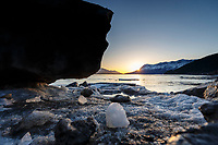 Spring landscape view of ice bergs and Turnagain Arm with snow-covered Chugach Mountains at sunset  April 2017<br /> <br /> Photo by Jeff Schultz/SchultzPhoto.com  (C) 2017  ALL RIGHTS RESERVED