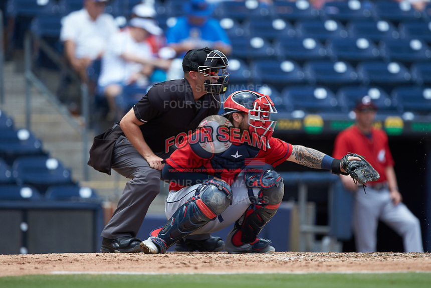 Columbus Clippers catcher Eric Haase (13) sets a target as home plate umpire Dan Merzel looks on during the game against the Durham Bulls at Durham Bulls Athletic Park on June 1, 2019 in Durham, North Carolina. The Bulls defeated the Clippers 11-5 in game one of a doubleheader. (Brian Westerholt/Four Seam Images)