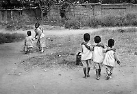 Children play in the relative safety of a day-care centre for orphans in Lilongwe, Malawi on March 8, 2001.  More than 13 million African children have been orphaned by the the AIDS pandemic. Worldwide, more than 20 million people have died since the first cases of AIDS were identified in 1981.