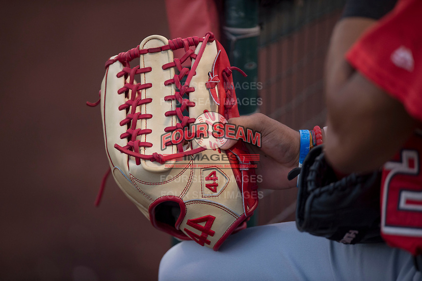 AZL Angels center fielder Jordyn Adams (21) holds his custom 44 professional glove during an Arizona League game against the AZL Padres 2 at Tempe Diablo Stadium on July 18, 2018 in Tempe, Arizona. The AZL Padres 2 defeated the AZL Angels 8-1. (Zachary Lucy/Four Seam Images)