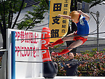 May 1, 2013, Tokyo, Japan - A participant in a comic costume gives a flying kick to the sandbag bearing a sign TPP during a May Day rally sponsored by the National Confederation of Trade Unions at a Tokyo park on Wednesday, May 1, 2013. Some 32,000 people took part in the rally, voicing their concerns for tax hike and constitutional revision among other things.  (Photo by Natsuki Sakai/AFLO)