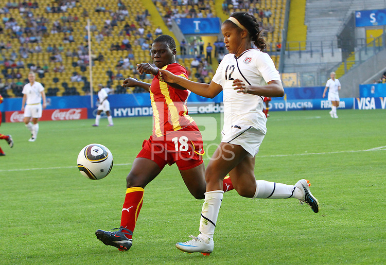 USA's Zakiya Bywaters (R) and Edem Atovor of Ghana during the FIFA U20 Women World Cup at the Rudolf Harbig Stadium in Dresden, Germany on July 14th, 2010.