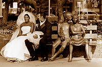 Model Relesed  FILE Photo, Montreal, Canada<br /> <br /> A newly wed multi ethnic couple sit on a publi bench beside a sculpture of a couple.<br /> <br /> Mandatory Credit: Photo by Pierre Roussel- Images Distribution. (©) Copyright 1999 by Pierre Roussel