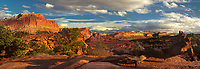 908000012 panoramic view - afternoon clouds form up over brilliant red sandstone formations and the waterpocket fold near sunset point in capitol reef national park utah