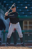 Dayton Dragons manager Todd Benzinger #25 hits ground balls during infield practice at Parkview Field April 16, 2009 in Fort Wayne, Indiana. (Photo by Brian Westerholt / Four Seam Images)
