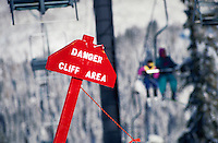 A danger sign and chairlift at Solitude Ski Area. Utah.
