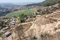 Bhaktapur, Nepal.  Terraced Hillsides above Rural  Villages near Bhaktapur.  Atmospheric Haze Caused by Brick-making Factories Nearby.